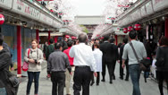 Stock Video Footage of People passing throuth the Nakamise-dori to Senso-ji temple, Japan
