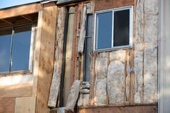 Stock Photo of angled view two windows under construction