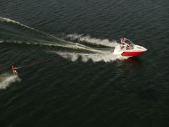 Aerial wide shot of wakeboarder Stock Footage