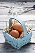 Eggs on a basket Stock Photos