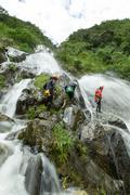 Canyoning Adventure Team In Chamana Waterfall Banos De Agua Santa Ecuador - stock photo