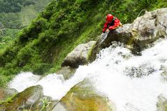 Stock Photo of Canyoning Instructor Opening A New Route In Chamana Waterfall Banos De Agua