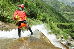 Stock Photo of Canyoning Guide Trying Out A New Route In Chama Waterfall Banos De Agua Santa