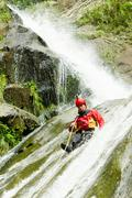 Waterfall Descent By A Professional Canyoning Instructor Stock Photos