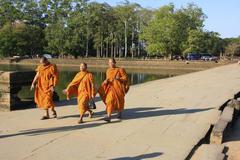 Monks walking into a temple, angkor wat Stock Photos