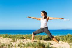 beach yoga - stock photo