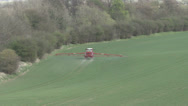 Stock Video Footage of Red crop sprayer rear view.