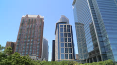 tilt down from panama city skyscrapers to reflecting pond - stock footage