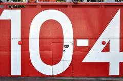 red japanese tsunami watertight door with the number 10-4 - stock photo