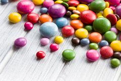 Three different sizes of colorful candies Stock Photos