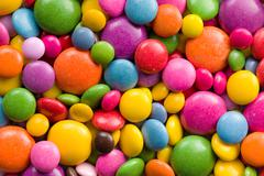 Stock Photo of three different sizes of colorful candies