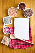 recipe book with a variety of candy sprinkles. - stock photo