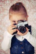 Young girl with analogue camera Stock Photos