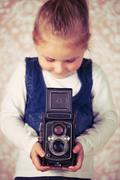 young girl with analogue camera - stock photo