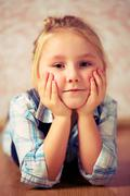 Beautiful little girl lying on floor Stock Photos