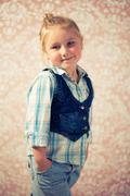 portrait of little girl before retro background - stock photo