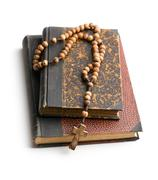 Holy bible and rosary beads Stock Photos