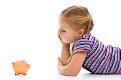 little girl with piggy bank - stock photo
