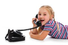 little girl with old retro phone. - stock photo