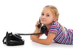 Little girl with old retro phone. Stock Photos