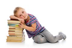 Little girl with a pile of books Stock Photos
