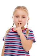 Little girl showing silence sign Stock Photos
