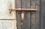 Stock Photo of wrought iron lock old wooden door