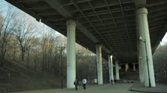 People in blur walking under the bridge. Stock Footage