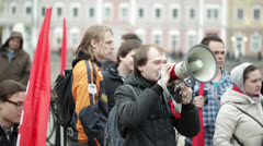 Young man shouting with a megaphone at the protest manifestation Stock Footage