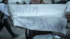 Woman holds a placard Putin Go Away. - stock footage