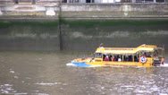 Stock Video Footage of Amphibious vehicle moving along river Thames in London, UK
