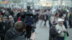 Cameraman shoots people at a crowded place. Stock Footage