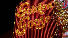 Flashing 'Golden Goose' Strip Club Sign Stock Footage