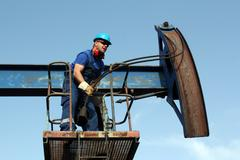 worker working in the oil field - stock photo