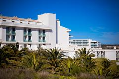 new resort apartment house against bright blue sky - stock photo