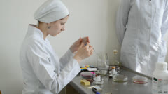 Young woman microbiologist Stock Footage
