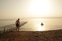 Bathing in the Dead Sea - stock photo