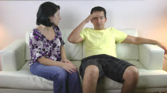 Woman comforting his sad husband Stock Footage
