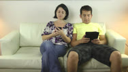 Stock Video Footage of Couple using smartphone and tablet