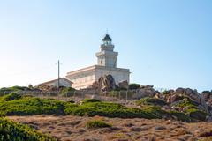 Lighthouse at capo testa, sardinia Stock Photos