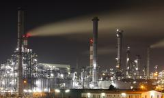 Oil and gas refinery at twilight - petrochemical factory Stock Photos