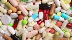 many colorful pills turning - stock footage