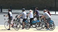 Tourists on 'Boris bikes' London, UK. Stock Footage