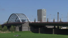John Frost Bridge. Lower Rhine, Arnhem - cyclists, traffic + zoom out Stock Footage