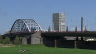 Stock Video Footage of John Frost Bridge. Lower Rhine, Arnhem - cyclists, traffic + zoom out