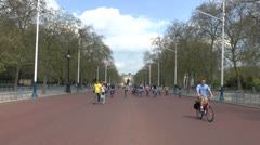 Cyclists riding along the Mall, London, UK. Stock Footage
