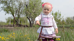 Cute baby on bicycle. Dolly shoot. Stock Footage
