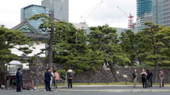 Soldiers at Kikyo-mon gate to the Imperial Palace in Tokyo, Japan Stock Footage