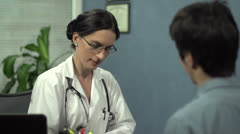 Female doctor talking to patient - stock footage