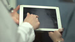 Doctor showing patient's x-ray of chest Stock Footage